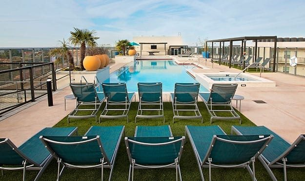 Rooftop Pool With Cabanas & Tanning Deck